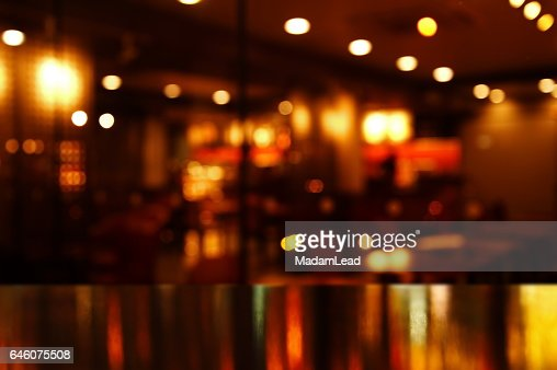 reflection light on table in bar and pub at night : Stock Photo