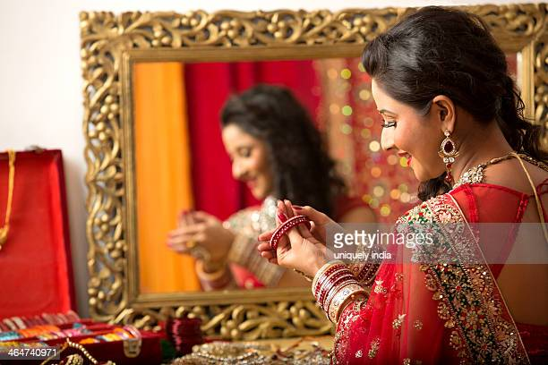 Reflection of a bridal woman in mirror