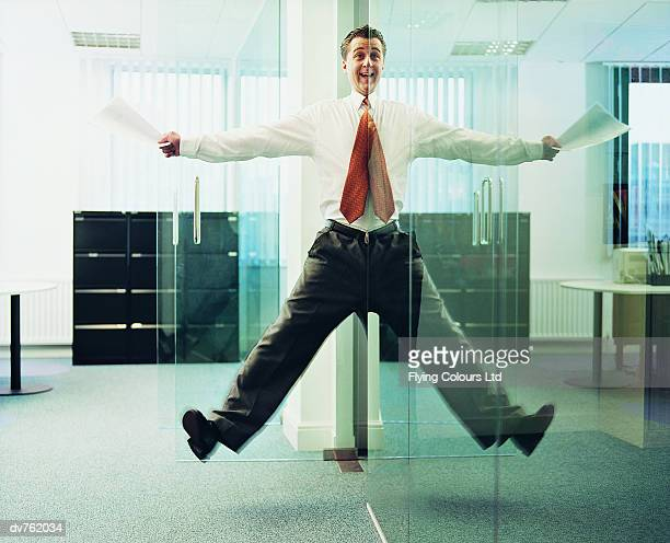 Reflection of a Businessman Giving Illusion That He's in Mid Air
