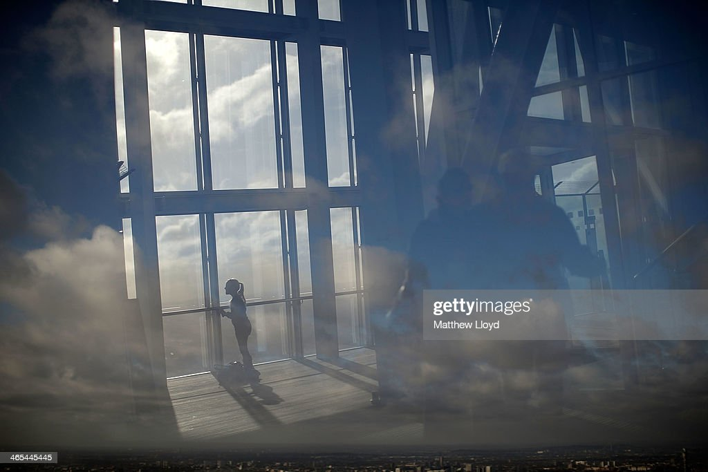 A reflection of a girl looks out over London from The View at The Shard on January 27, 2014 in London, England. A study has found that one in three 22-30 year olds are leaving their hometowns to move to the capital, which creates ten times as many private sector jobs as any other city.
