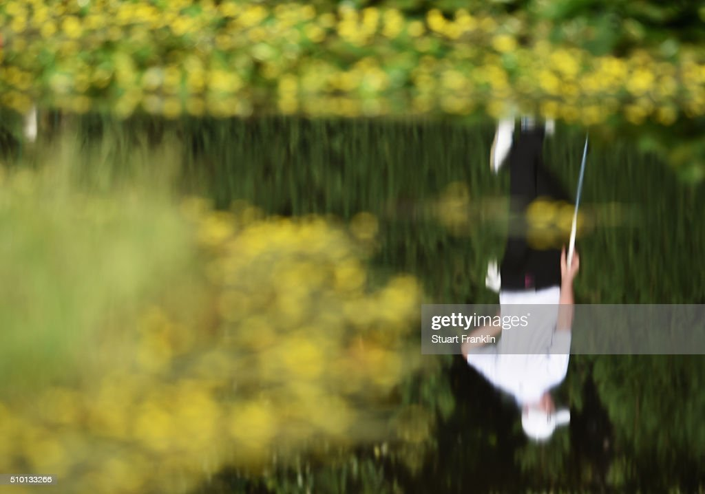 A reflection of a golfer in a pond during the final round of the Tshwane Open at Pretoria Country Club on February 14, 2016 in Pretoria, South Africa.