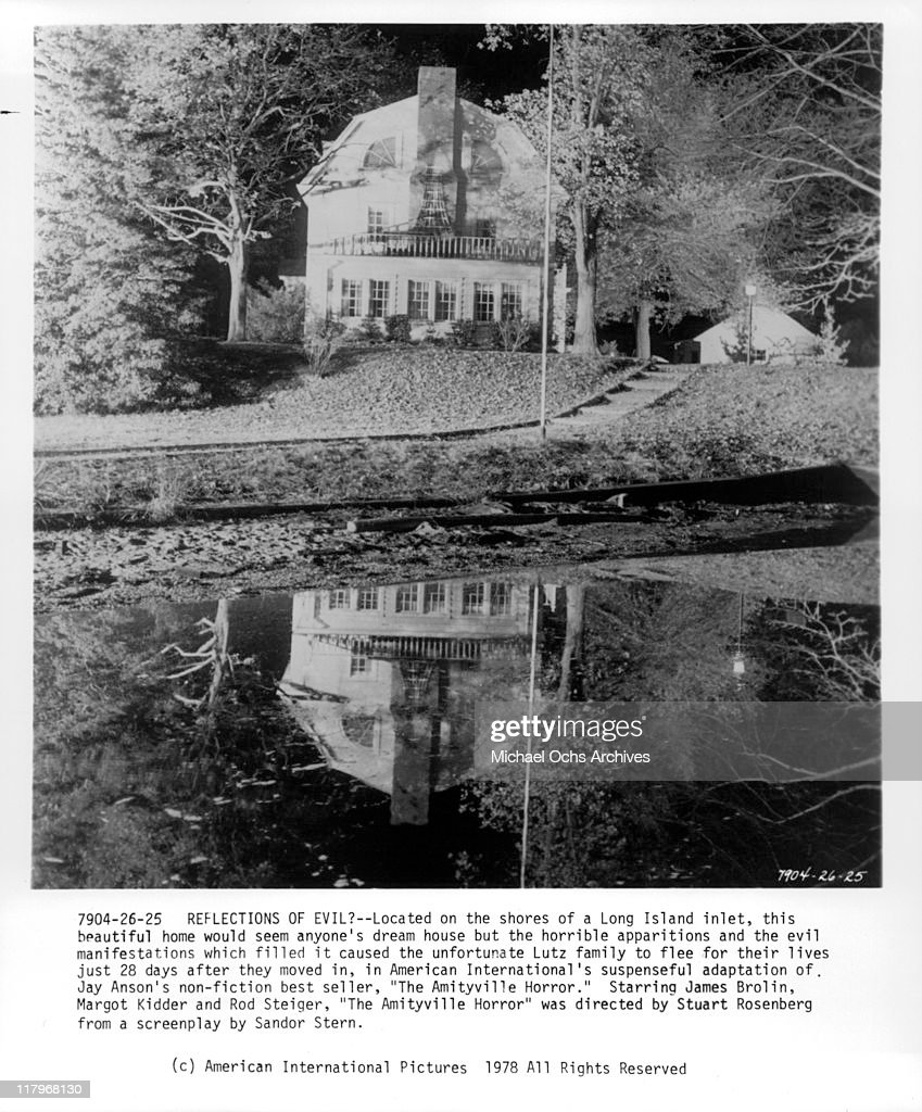Reflection of a house in water in a scene from the film 'The Amityville Horror', 1979.