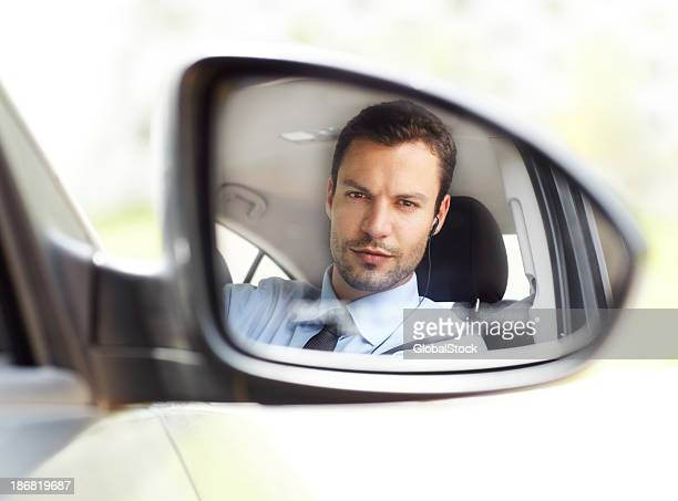Reflection of a man in side car mirror