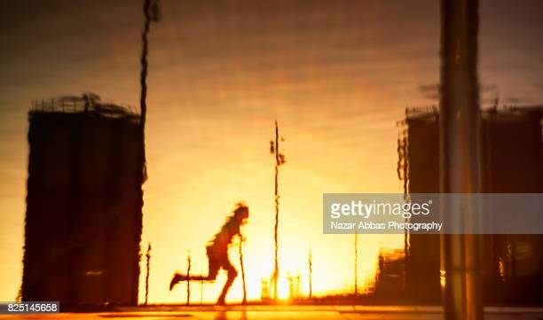 Reflection of a skateboarder with sunset in background.