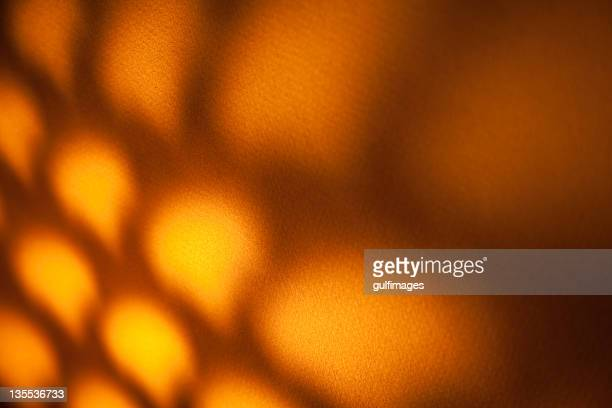 Reflection of an illuminated lantern with lattice pattern