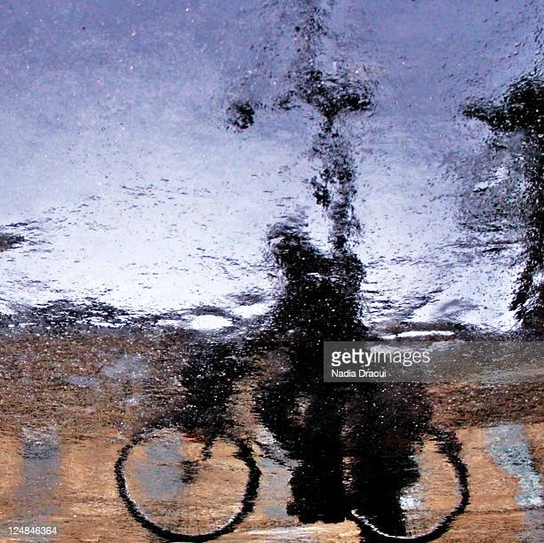 Reflection of bike in puddle