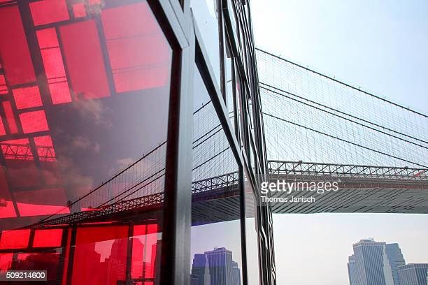 Reflection of Brooklyn Bridge in stained glass house, New York City