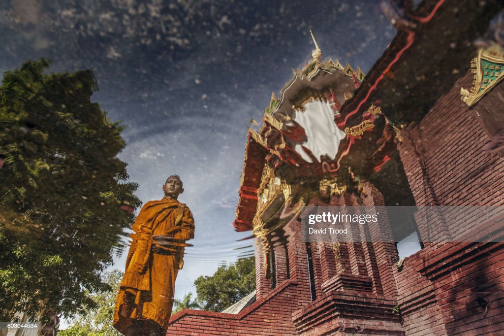 Reflection of Buddhist monk in water : Stock Photo