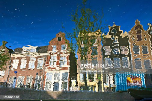 Reflection of buildings in a canal, Amsterdam, Holland, Netherlands : Stock Photo