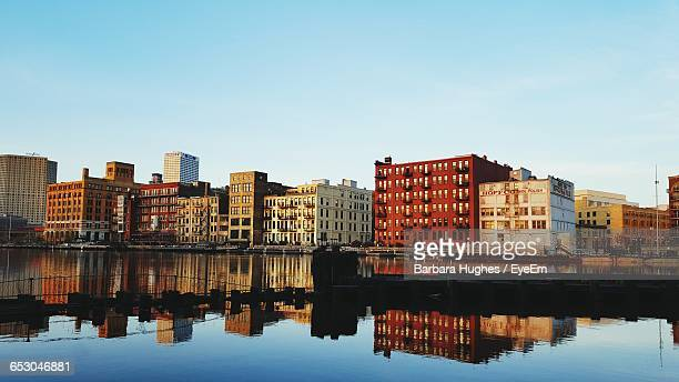 Reflection Of Buildings In Calm Water