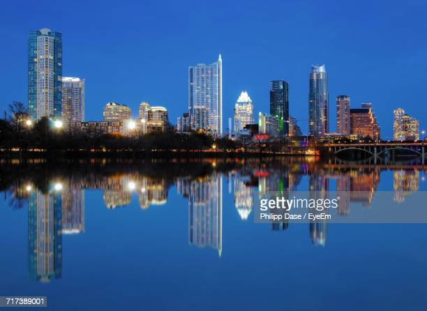 Reflection Of Buildings In Lake Water