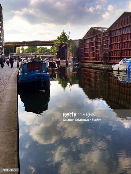 Reflection of built structures and boat in water