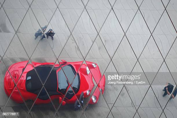 Reflection Of Car On Building