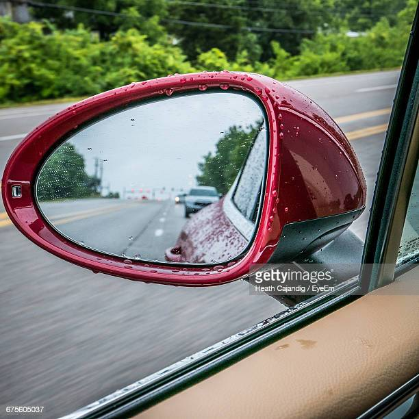 Reflection Of Cars Seen On Rear-View Mirror