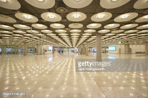 Reflection of ceiling lights on the floor inside a building : Stock Photo