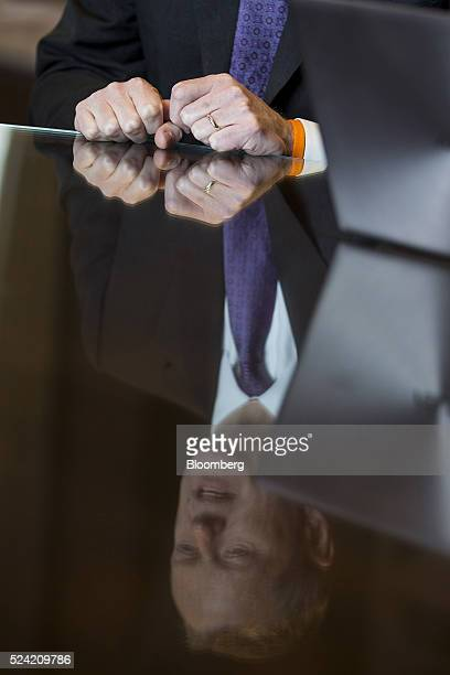 A reflection of Charles 'Charlie' Baker governor of Massachusetts is seen during an interview at the Statehouse in Boston Massachusetts US on Monday...