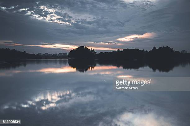 Reflection of clouds during sunset. Shot at the lake in a recreational park.