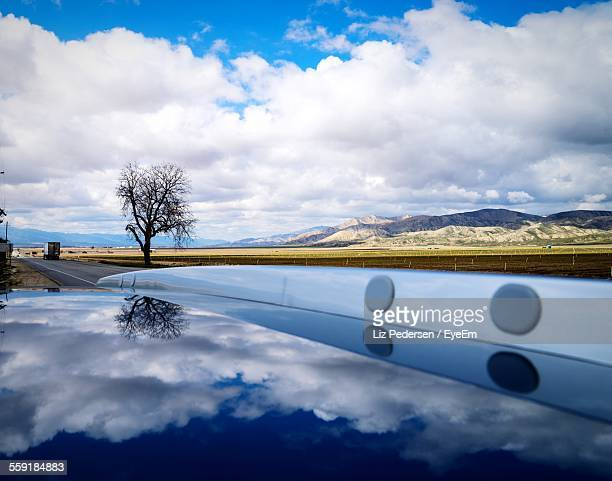 Reflection Of Clouds In Car Roof