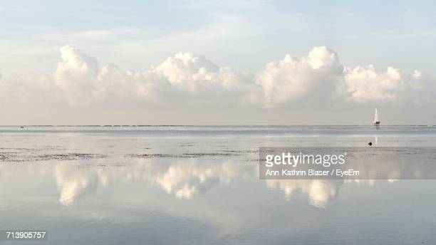 Reflection Of Clouds In Sea