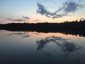 A small calm lake one summer evening