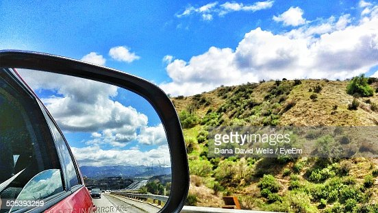 Reflection of Clouds On Car Side-View Mirror