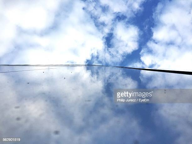 Reflection Of Cloudy Sky On Glass Building