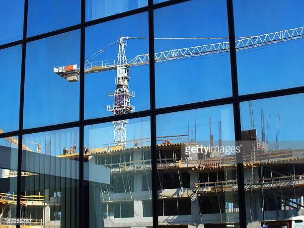 Reflection of construction site on office building