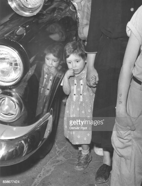 Reflection of DeathThe horror of seeing death for the first time is registered on the face of this unidentified child standing by a police car near...