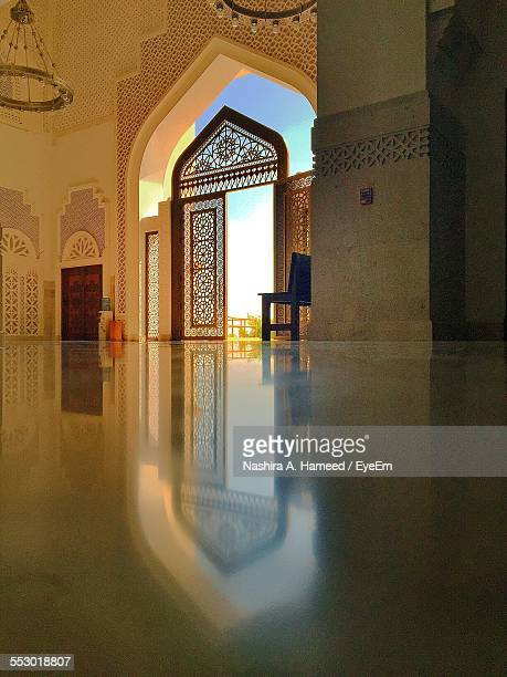 Reflection Of Door On Tiled Floor