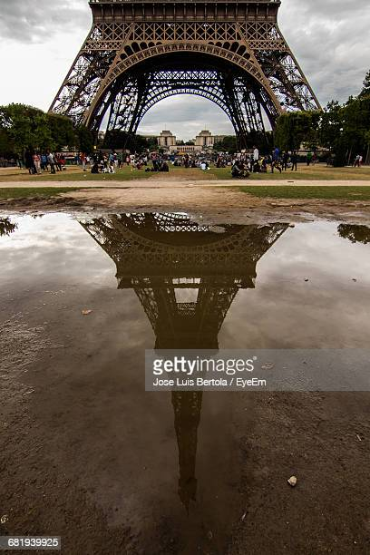 Reflection Of Eiffel Tower On Puddle
