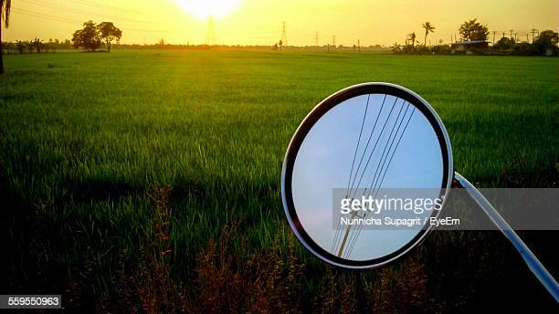 Reflection Of Electricity Pylon In Side-View Motor Bicycle Mirror