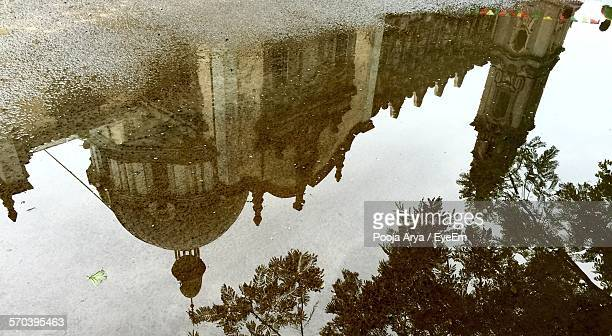 Reflection Of Holy Trinity Cathedral On Puddle In Street