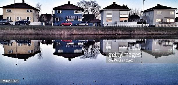Reflection Of Houses On River In Town