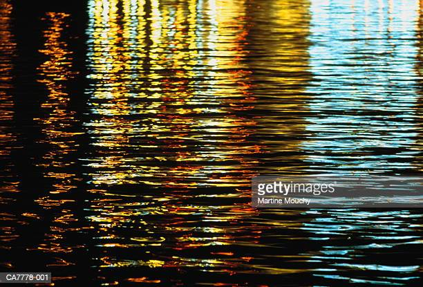 Reflection of illuminated buildings in river, night