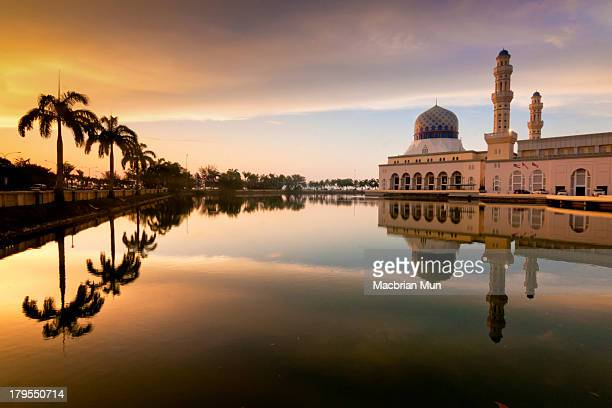 Reflection of Kota Kinabalu mosque at sunset