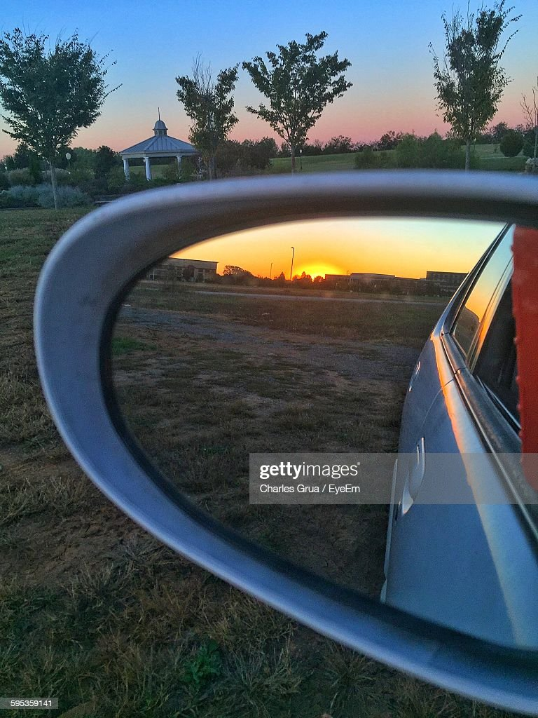 Reflection Of Landscape In Car Rear View Mirror