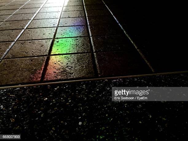 Reflection Of Light On Paving Stone At Night