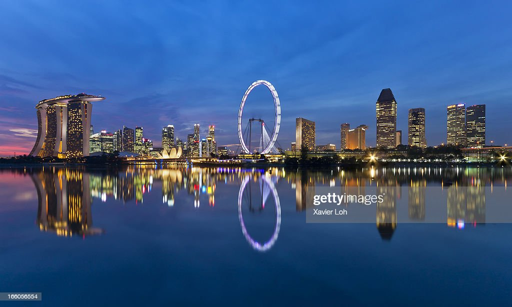 Reflection of lighted buildings at twilight