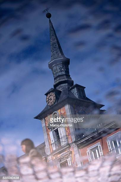 Reflection of Madrid Town Hall in Puddle at Plaza Mayor