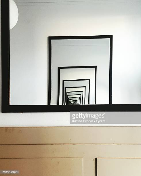 Reflection Of Mirror Mounted On Wall