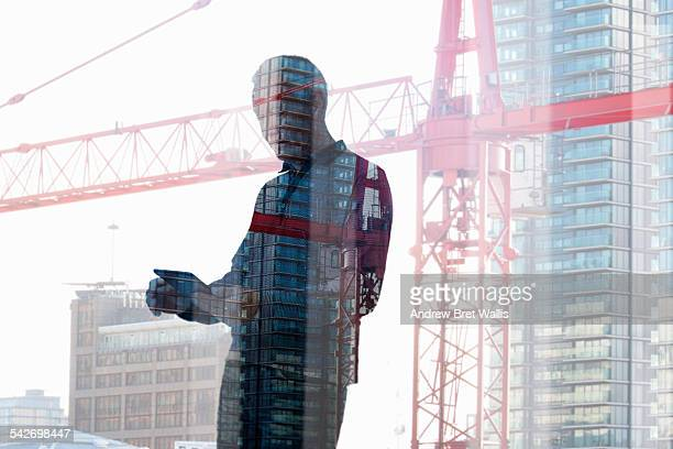 Reflection of mobile user near construction site