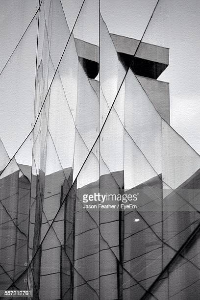 Reflection Of Modern Building On Glass