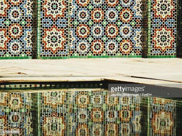Reflection Of Mosaic Wall In Swimming Pool