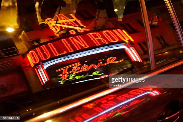 Reflection of Moulin Rouge in car window