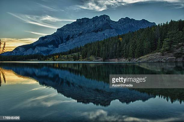 Reflection of mountain and trees in tranqil lake