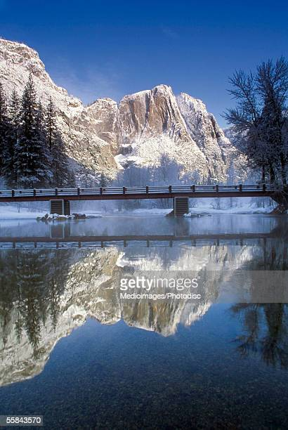 Reflection of mountains in a lake, Yosemite National Park, Mariposa County, California