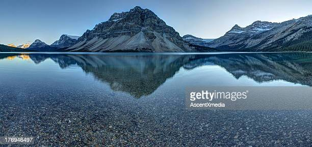Reflection of mountains on tranquil lake surface