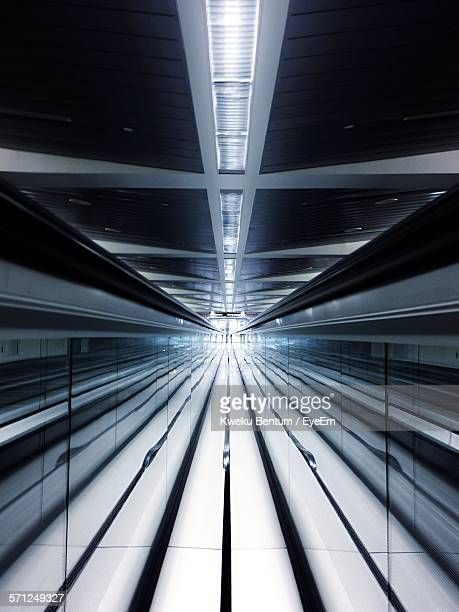 Reflection Of Moving Walkway On Mirror