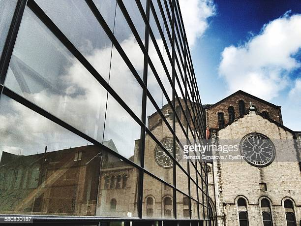 Reflection Of Old Church On Modern Building