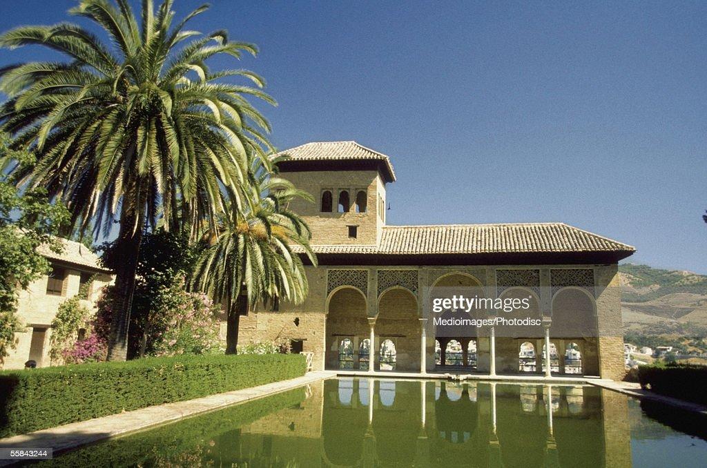 Reflection of Palacio Del Partal in water, Alhambra Palace, Granada, Spain